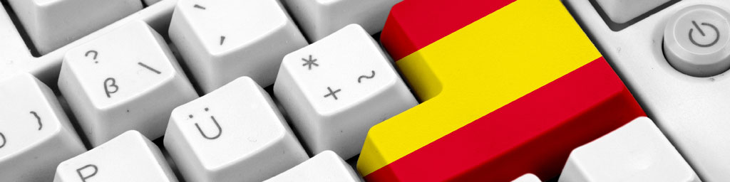 Native Speaker Spanisch buchen bei Stimmenkartei - Spanische Flagge auf der Enter-Taste